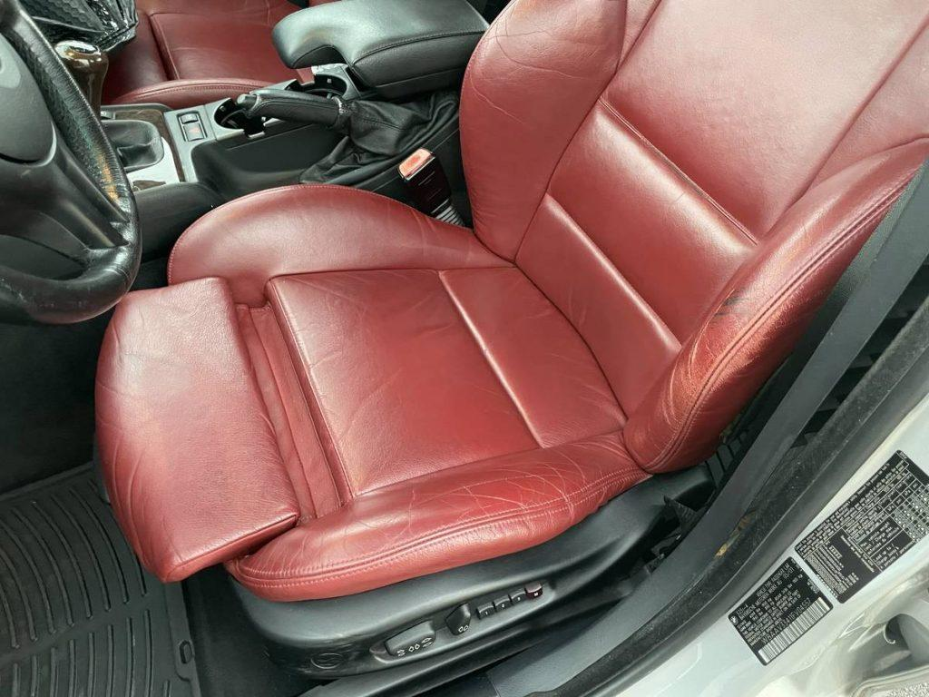 2001 BMW 325i driver's seat in red